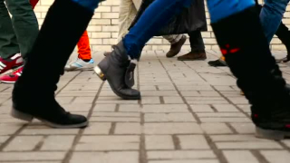 Depositphotos_201317770-stock-video-feet-of-people-delayed-shooting