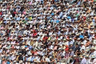 Depositphotos_72421783-stock-photo-crowd-watch-bullfighting